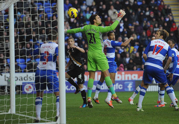 READING, ENGLAND - OCTOBER 27:  Chris Baird of Fulham watches as his header goes past goalkeeper Alex McCarthy of Reading for Fulham's second goal during the Barclays Premier League match between Reading and Fulham at Madejski Stadium on October 27, 2012