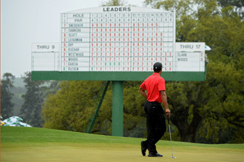 Tiger Woods stares at the scoreboard and wonders about what might have been.