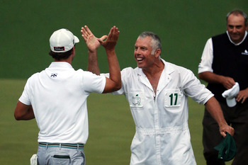 Adam Scott celebrates with caddie Stevie Williams.