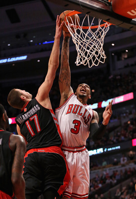 Malcolm Thomas gets blocked against the Raptors' Jonas Valanciunas.