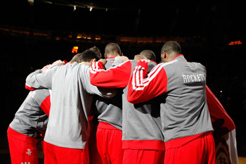 Houston Rockets huddle up during the Sacramento Kings game.