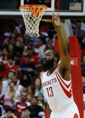 HOUSTON, TX - APRIL 14:  James Harden #13 of the Houston Rockets celebrates a three point shot during the game against the Sacramento Kings at the Toyota Center on April 14, 2013 in Houston, Texas. NOTE TO USER: User expressly acknowledges and agrees that