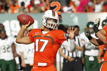 MIAMI GARDENS, FL - NOVEMBER 17: Stephen Morris #17 of the Miami Hurricanes throws the ball against the South Florida Bulls on November 17, 2012 at Sun Life Stadium in Miami Gardens, Florida. (Photo by Joel Auerbach/Getty Images)