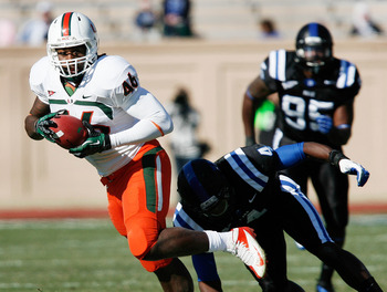 Nov 24, 2012; Durham, NC, USA; Miami Hurricanes tight end Clive Walford (46) runs past Duke Blue Devils safety Walt Canty (4) during the first half at Wallace Wade Stadium.  Mandatory Credit: Mark Dolejs-USA TODAY Sports