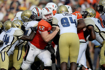 Sep 22, 2012; Atlanta, GA, USA; Miami Hurricanes offensive lineman Shane McDermott (62) in action against the Georgia Tech Yellow Jackets at Bobby Dodd Stadium. Miami won 42-36 in overtime. Mandatory Credit: Kevin Liles-USA TODAY Sports