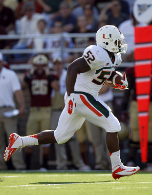 Sep 1, 2012; Chestnut Hill, Massachusetts, USA; Miami Hurricanes line backer Denzel Perryman (52) carries the ball after an interception during the first quarter against the Boston College Eagles at Alumni Stadium.   Mandatory Credit: Greg M. Cooper-USA T