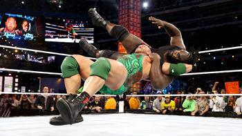 Ryback hits Shell Shocked on Mark Henry. (Photo from WWE.com)