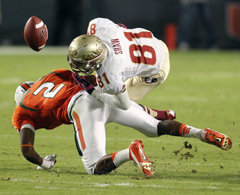 Oct 20 2012; Miami Gardens, FL, USA;  Miami Hurricanes defensive back Deon Bush (2) breaks up a pass to Florida State Seminoles wide receiver Kenny Shaw (81) in the first quarter at Sun Life Stadium.  Mandatory Credit: Robert Mayer-USA TODAY Sports