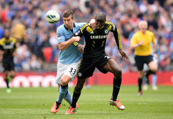 LONDON, ENGLAND - APRIL 14:  Matija Nastasic of Manchester City and Demba Ba of Chelsea battle for the ball during the FA Cup with Budweiser Semi Final match between Chelsea and Manchester City at Wembley Stadium on April 14, 2013 in London, England.  (Ph