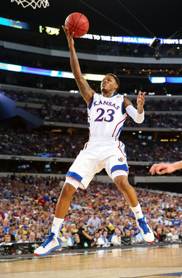 Mar 29, 2013; Arlington, TX, USA; Kansas Jayhawks guard Ben McLemore (23) shoots against the Michigan Wolverines during the semifinals of the South regional of the 2013 NCAA Tournament at Cowboys Stadium. Mandatory Credit: Kevin Jairaj-USA TODAY Sports