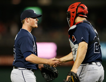 WASHINGTON, DC - APRIL 12: Relief pitcher Craig Kimbrel #46 of the Atlanta Braves is congratulated by catcher Evan Gattis #24 after the Braves defeated the Washington Nationals 6-4 in extra innings at Nationals Park on April 12, 2013 in Washington, DC.  (