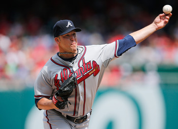 WASHINGTON, DC - APRIL 14: Starting pitcher Paul Maholm #28 of the Atlanta Braves throws to a Washington Nationals batter during the first inning at Nationals Park on April 14, 2013 in Washington, DC.  (Photo by Rob Carr/Getty Images)