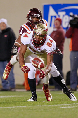 Smith dives for a pass against Virginia Tech.
