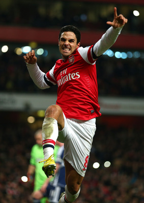 LONDON, ENGLAND - DECEMBER 08:  Mikel Arteta of Arsenal celebrates scoring their second goal from the penalty spot during the Barclays Premier League match between Arsenal and West Bromwich Albion at Emirates Stadium on December 8, 2012 in London, England