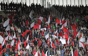 I couldn't find any photos of Nacional fans, so this is just a random picture of football fans. I think they are AZ Alkmaar.
