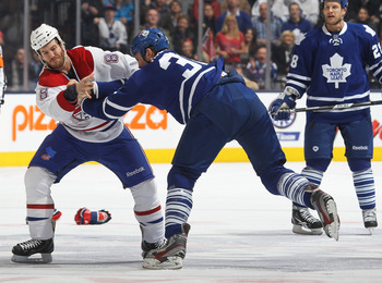 Montreal Canadien Brandon Prust fights Toronto Maple Leaf Frazer McLaren.
