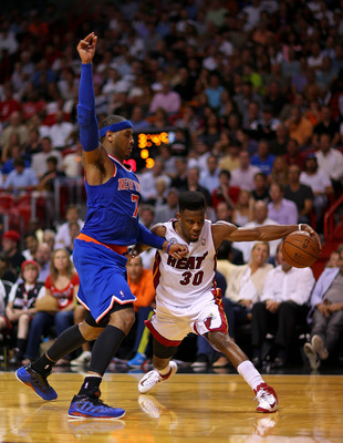 MIAMI, FL - APRIL 02: Norris Cole #30 of the Miami Heat drives on Carmelo Anthony #7 of the New York Knicks during a game  at American Airlines Arena on April 2, 2013 in Miami, Florida.  NOTE TO USER: User expressly acknowledges and agrees that, by downlo