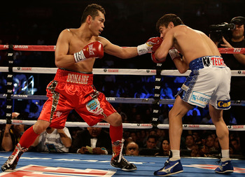 Donaire pounded Jorge Arce into retirement with left hooks like this one, en route to a third-round KO win last December.
