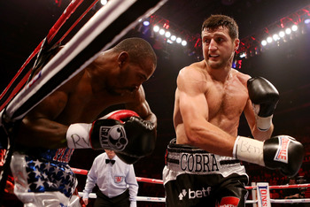 Froch turned his career around in 2012 with consecutive stoppages of Lucian Bute and Yusaf Mack (above) in a combined eight rounds.