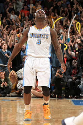 DENVER, CO - MARCH 01:  Ty Lawson #3 of the Denver Nuggets celebrates after hitting the game winning shot against the Oklahoma City Thunder in the finals seconds at the Pepsi Center on March 1, 2013 in Denver, Colorado. The Nuggets defeated the Thunder 10