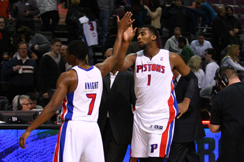 Jan 22, 2013; Auburn Hills, MI, USA; Detroit Pistons point guard Brandon Knight (7) and center Andre Drummond (1) celebrate after the game against the Orlando Magic at The Palace of Auburn Hills. The Pistons won 105-90. Mandatory Credit: Raj Mehta-USA TOD