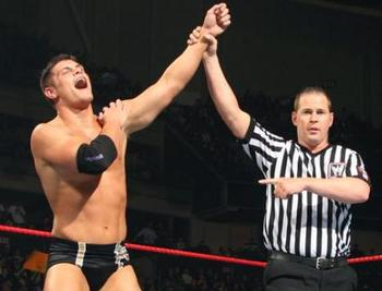 Before Rhodes started his own wrestling career he served as a ref for his dad's promotion. Photo Courtesy of WWE.com