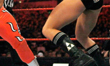 As you can see on Rhodes' boots, he used to sport the tri-force symbol from the Legend of Zelda video game series. Photo Courtesy of WWE.com