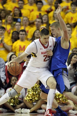 Feb 16, 2013; College Park, MD, USA; Duke Blue Devils forward Mason Plumlee (5) defends against Maryland Terrapins center Alex Len (25) at the Comcast Center. Mandatory Credit: Mitch Stringer-USA TODAY Sports
