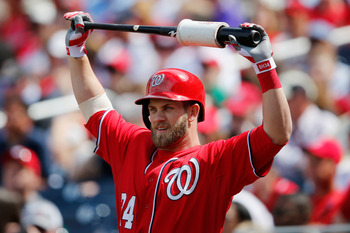 WASHINGTON, DC - APRIL 14: Bryce Harper #34 of the Washington Nationals waits to bat against the Atlanta Braves at Nationals Park on April 14, 2013 in Washington, DC.  (Photo by Rob Carr/Getty Images)