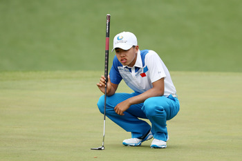 Too much time over shots, like this putt, make Guan a slow player.