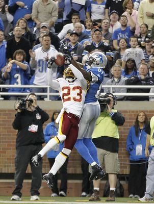 DeAngelo Hall rips a pass away from Calvin Johnson.
