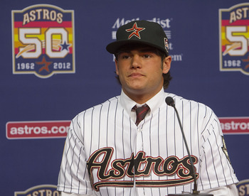 HOUSTON, TX - JUNE 18: Right-handed pitcher Lance McCullers, who was selected in the compensation first round (41st overall) of the 2012 MLB First Year Player Draft, is introduced during a press conference at Minute Maid Park on June 18, 2012 in Houston,
