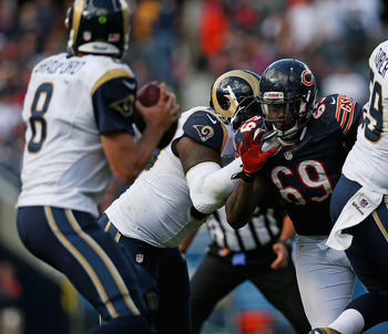 Henry Melton and the Bears will try to bring the pressure against Sam Bradford.