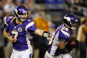 Christian Ponder handing the ball off to Adrian Peterson against the Bears.