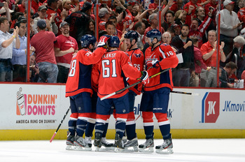 WASHINGTON, DC - APRIL 16:  Jack Hillen #38 of the Washington Capitals celebrates with teammates after scoring in the first period against the Toronto Maple Leafs at the Verizon Center on April 16, 2013 in Washington, DC.  (Photo by Greg Fiume/Getty Image