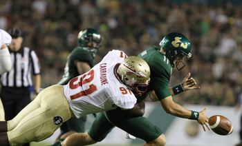 September 29, 2012; Tampa, FL, USA; Florida State Seminoles defensive end Cornellius Carradine (91) forces South Florida Bulls quarterback Matt Floyd (11) to fumble the ball during the second half at Raymond James Stadium. Florida State Seminoles defeated