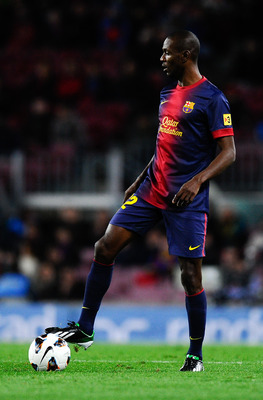BARCELONA, SPAIN - APRIL 06:  Eric Abidal of FC Barcelona runs with the ball during the La Liga match between FC Barcelona and RCD Mallorca at Camp Nou on April 6, 2013 in Barcelona, Spain.  (Photo by David Ramos/Getty Images)