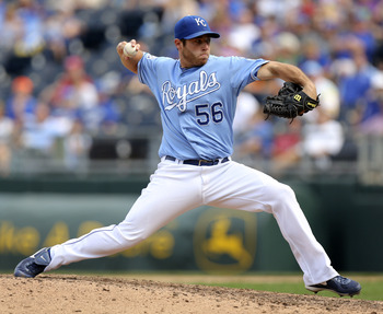 Greg Holland is holding on to the closer's role for dear life.