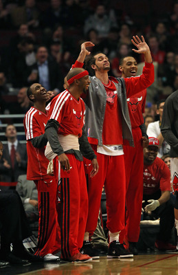Marquis Teague (far left) and Malcolm Thomas (far right) could learn a lot from playing with Rose.
