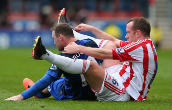 Stoke's Charlie Adam shows Wayne Rooney the correct procedure for rowing a boat across the Channel.