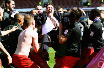 Malky Mackay enjoys the fruits of a hard season's graft.