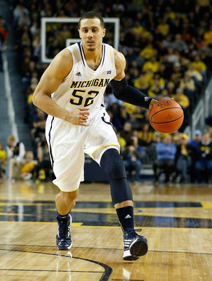 Jordan Morgan will be back in the starting lineup for Michigan next season.