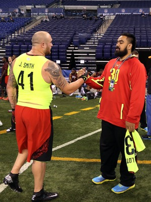 Feb 25, 2013; Indianapolis, IN, USA; New Hampshire defensive lineman Jared Smith (41) shakes hands with Utah Utes defensive lineman Star Lotulelei (30) during the NFL Combine at Lucas Oil Stadium.  Mandatory Credit: Brian Spurlock-USA TODAY Sports
