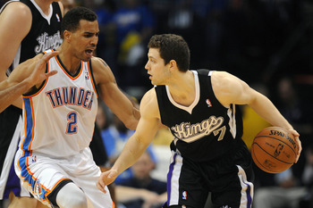 Apr 15, 2013; Oklahoma City, OK, USA; Sacrament Kings guard Jimmer Fredette (7) handles the ball against Oklahoma City Thunder guard Thabo Sefolosha (2) during the second half at Chesapeake Energy Arena. Mandatory Credit: Mark D. Smith-USA TODAY Sports