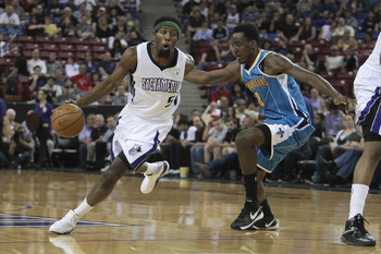 April 10, 2013; Sacramento, CA, USA; Sacramento Kings small forward John Salmons (5) drives in ahead of New Orleans Hornets small forward Al-Farouq Aminu (0) during the first quarter at Sleep Train Arena. Mandatory Credit: Kelley L Cox-USA TODAY Sports