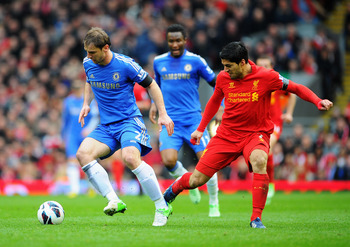 LIVERPOOL, ENGLAND - APRIL 21:  Branislav Ivanovic of Chelsea is challenged by Luis Suarez of Liverpool during the Barclays Premier League match between Liverpool and Chelsea at Anfield on April 21, 2013 in Liverpool, England.  (Photo by Michael Regan/Get
