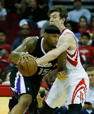 HOUSTON, TX - APRIL 14:  DeMarcus Cousins #15 of the Sacramento Kings drives into Omer Asik #3 of the Houston Rockets during the game at the Toyota Center on April 14, 2013 in Houston, Texas. NOTE TO USER: User expressly acknowledges and agrees that, by d