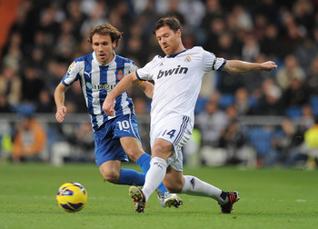 Pass master Xabi Alonso in action.