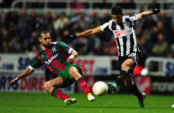 Hatem Ben Arfa battles in UEFA Europa League action.