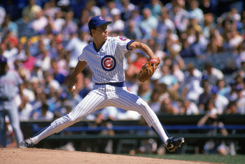 CHICAGO -1988:  Greg Maddux #31 of the Chicago Cubs winds back to pitch during a game against the New York Mets in the 1988 season at Wrigley Field in Chicago, Illinois. ( Photo by: Jonathan Daniel/ Getty Images )